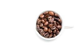 Opinión superior una taza de granos de café con el espacio para el texto Imagen de archivo