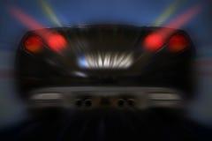 Opinión trasera del coche rápido Foto de archivo libre de regalías