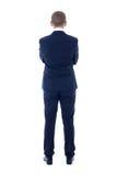 Opinión trasera el hombre joven en el traje de negocios aislado en blanco Foto de archivo