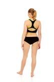 Opinión trasera la mujer atlética joven en ropa interior de los deportes Imagen de archivo libre de regalías