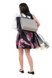Opinión trasera la mujer con los bolsos de compras. Imagen de archivo