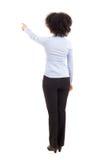 Opinión trasera la mujer de negocios afroamericana que señala en el somethi Foto de archivo