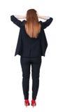 Opinión trasera la mujer de negocios chocada en traje Imagen de archivo