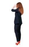 Opinión trasera la mujer de negocios chocada en traje Imágenes de archivo libres de regalías