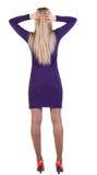 Opinión trasera la mujer de negocios chocada en vestido Fotos de archivo libres de regalías