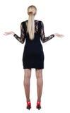 Opinión trasera la mujer de negocios chocada en vestido. Imágenes de archivo libres de regalías