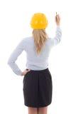 Opinión trasera la mujer de negocios en la escritura del casco del constructor algo Fotos de archivo libres de regalías