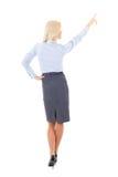 Opinión trasera la mujer de negocios joven que señala en algo aislado Fotos de archivo