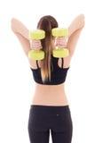 Opinión trasera la mujer delgada hermosa joven con pesas de gimnasia aislada Imagen de archivo