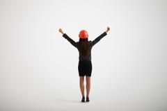 Opinión trasera la mujer en casco del desgaste formal y de la construcción Foto de archivo libre de regalías