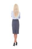 Opinión trasera la mujer hermosa joven en el traje de negocios aislado encendido Fotografía de archivo libre de regalías