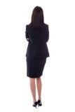 Opinión trasera la mujer joven en el traje de negocios aislado en blanco Fotos de archivo