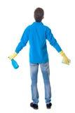 Opinión trasera un hombre más limpio en guantes con la esponja y el detergente Imágenes de archivo libres de regalías