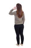 Opinión trasera una mujer que habla en el teléfono Imágenes de archivo libres de regalías