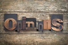 Opiniões, palavra escrita com bloco de impressão da tipografia do vintage Imagem de Stock