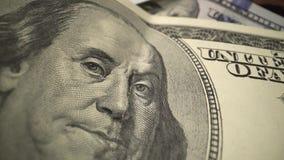 Opini?n macra del efectivo de USD efectivo verde de 100 d?lares - pare la animaci?n del movimiento Dinero de los E.E.U.U. autoriz almacen de metraje de vídeo