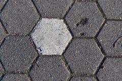Opini?nes cercanas detalladas sobre las calles y las aceras del guijarro en perspectivas distintas imagenes de archivo