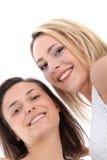 Opinión de ángulo inferior mujeres sonrientes Imágenes de archivo libres de regalías