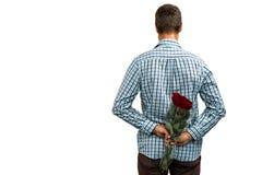 Opinião traseira rosas escondendo do homem Fotografia de Stock