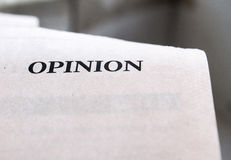 Opinion. Photograph of a paper, which is printed with Opinion text Royalty Free Stock Photography
