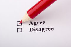 Opinion Poll. A red pencil laying on an opinion poll Stock Image