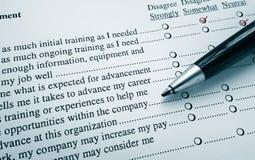 Opinion survey. Closeup of an employee survey with red pen marks stock photos