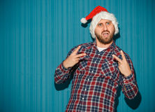 The opinionated christmas man wearing a santa hat Royalty Free Stock Photography