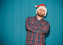 The opinionated christmas man wearing a santa hat Stock Photos