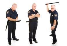 Opiniones del oficial de policía tres Imágenes de archivo libres de regalías