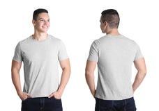 Opiniones delanteras y traseras el hombre joven en camiseta gris fotos de archivo libres de regalías