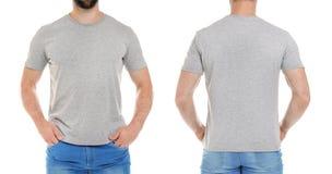 Opiniones delanteras y traseras el hombre joven en camiseta gris imagen de archivo libre de regalías