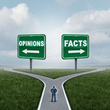 Opinions Or Facts. Dilemma as a person standing at a crossroad or junction between opinion and fact signs with opposite arrow directions as an evidence or proof Royalty Free Stock Image
