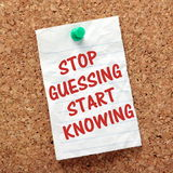 Opinions versus Facts Concept. The phrase Stop Guessing Start Knowing on a paper note pinned to a cork notice board, as a reminder we operate best when in stock photo