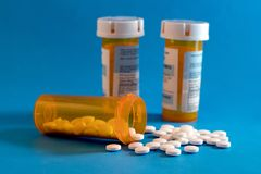 Opioid Crisis - Open Bottle of Prescription Painkillers. Medicare, overdose. Stock Photography