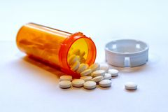Opioid Crisis - Open Bottle of Prescription Painkillers Stock Photo
