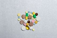 Opioid Pills. Colored pills on a silver background.The concept of Opioid epidemic.  Stock Image