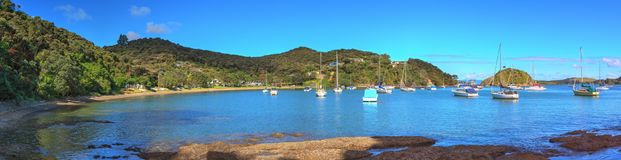 Northland, New Zealand. Long banner panorama of Opito bay. Opito Bay, near Kawakawa in the subtropical far north of New Zealand. Shown here in summer, when the Royalty Free Stock Image