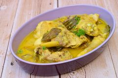 Opor ayam. Chicken cooked in coconut milk and spices royalty free stock photos