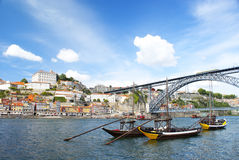 Oporto. City, three rabelo boats in the River Douro at day, framed by the old city and D. Luis Bridge, Portugal Stock Photo