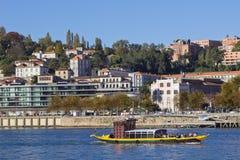 Oporto Douro River. A view of a touristic typical passenger boat at Oporto Douro River, Portugal Royalty Free Stock Image