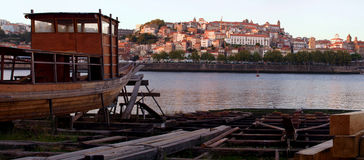 Oporto historic center and river view. Tipical view of historic Ribeira ancient buildings,and river with rabelo wine barrels boat in contruction work place stock photo