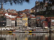 Oporto historic center and river view. Tipical view of historic Ribeira ancient buildings,and river with rabelo wine barrels boats transport Stock Images