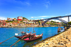 Oporto or Porto skyline, Douro river, boats and iron bridge. Por. Oporto or Porto city skyline, Douro river, traditional boats and Dom Luis or Luiz iron bridge Stock Photography