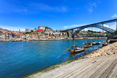 Oporto or Porto skyline, Douro river, boats and iron bridge. Portugal, Europe. Royalty Free Stock Photography