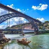 Oporto or Porto skyline, Douro river, boats and iron bridge. Portugal, Europe. Oporto or Porto city skyline, Douro river, traditional boats and Dom Luis or Luiz Royalty Free Stock Photos