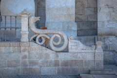 Detailed front view of part of the exterior staircase of the Porto Cathedral, sitting woman unidentifiable stock photo