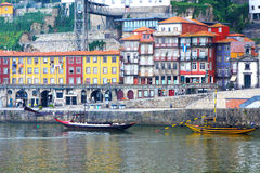 Oporto Ribeira, Portugal. Oporto famous landmark Ribeira with its old docks and ancient Rabelo boats used to transport port wine from vineyards along the river Stock Photos