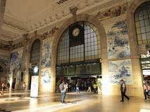 Oporto S.Bento train station interior. Ancient and historic S.Bento station interior bulding with people crossing Stock Photography