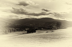Oppdal cottages with power line sepia background Stock Photos