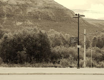 Oppdal street lamp and train communications sepia background Royalty Free Stock Images